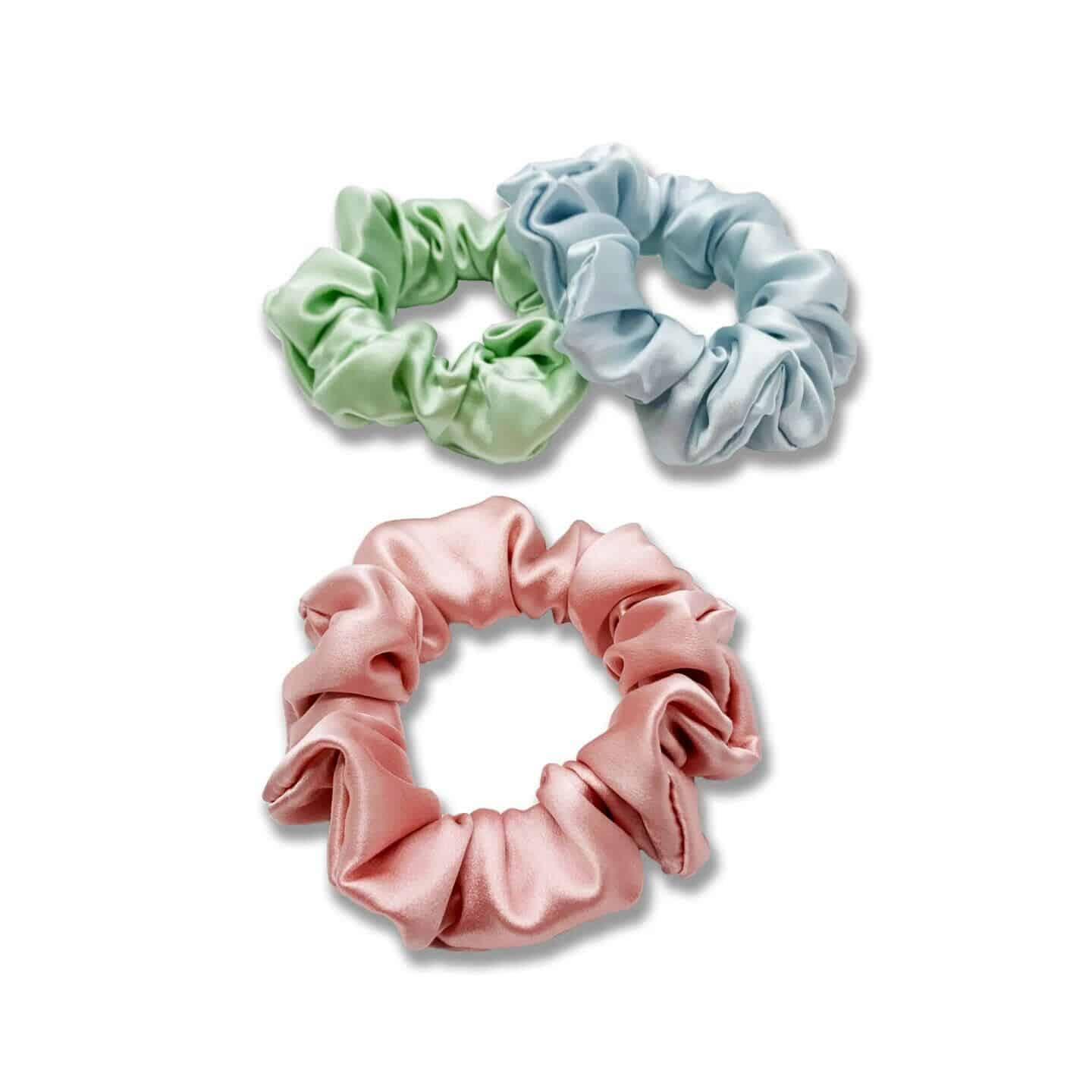 an image of 3 pastel silk scrunchies for natural hair